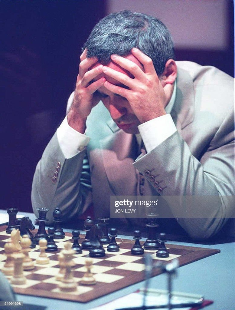 World Chess Champion Gary Kasparov from Russia holds his head in his hands as he contemplates a move in the World Chess Championship match against Vichy Anand of India 11 September in New York. The two chess Grand Masters will be playing for the title of World Chess Champion with the winner collecting USD 1 million in prize money.
