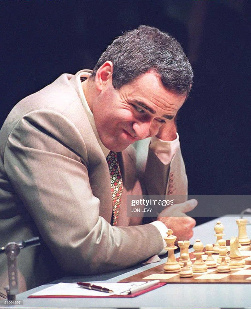 World Chess Champion Gary Kasparov of Russia grimaces as he sizes up his next move during the fourth game in the best of twenty World Chess Championship match with Vichy Anand of India 15 September in New York. The match is still drawn after the third game of 36 moves was declared a draw 14 September. AFP PHOTO