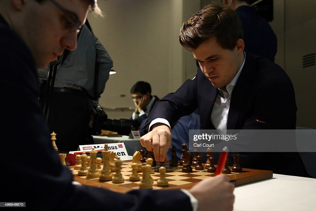 World chess champion <a gi-track='captionPersonalityLinkClicked' href=/galleries/search?phrase=Magnus+Carlsen&family=editorial&specificpeople=2602660 ng-click='$event.stopPropagation()'>Magnus Carlsen</a> makes a move against Maxime Vachier-Lagrave in an opening game at the London Chess Classic tournament on December 4, 2015 in London, England. As well as a British knockout championship, the tournament will see nine super-grandmasters compete in the final leg of the Grand Chess Tour.