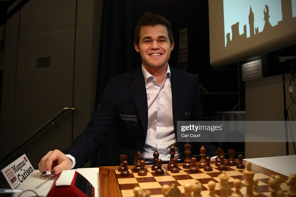 World chess champion <a gi-track='captionPersonalityLinkClicked' href=/galleries/search?phrase=Magnus+Carlsen&family=editorial&specificpeople=2602660 ng-click='$event.stopPropagation()'>Magnus Carlsen</a> smiles between moves as he plays Maxime Vachier-Lagrave in an opening game at the London Chess Classic tournament on December 4, 2015 in London, England. As well as a British knockout championship, the tournament will see nine super-grandmasters compete in the final leg of the Grand Chess Tour.