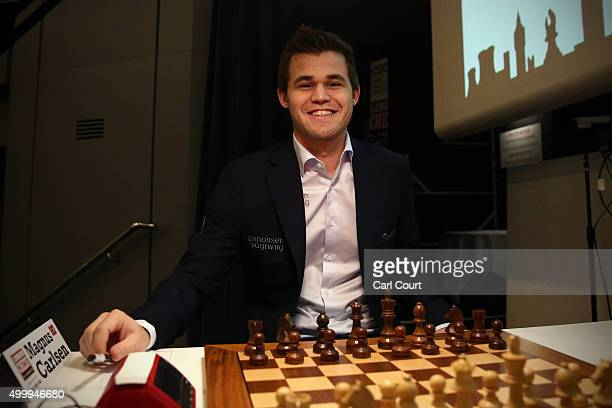 World chess champion Magnus Carlsen smiles between moves as he plays Maxime VachierLagrave in an opening game at the London Chess Classic tournament...
