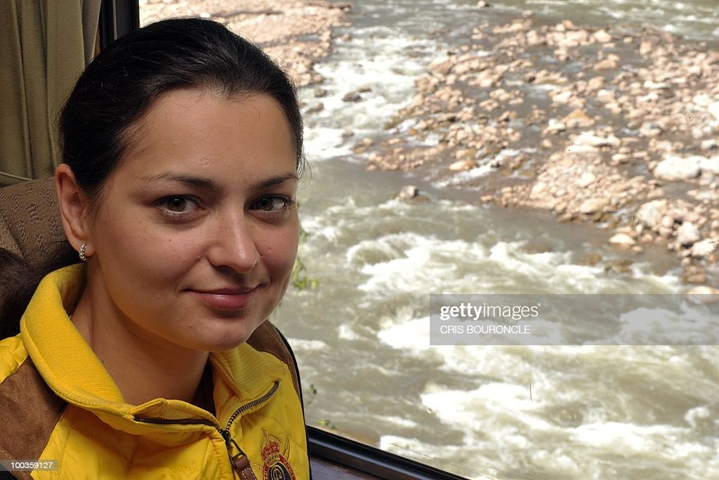 World chess champion Russian Alexandra Kosteniuk sits in a train as it moves by the torrential river Vilcanota on the way to the Inca citadel of Machu-Picchu, 1,215 km south east of Lima, on May 23, 2010. Kosteniuk will play an exhibition set of games against Peruvian Under-16 female world champion Deysi Cori.