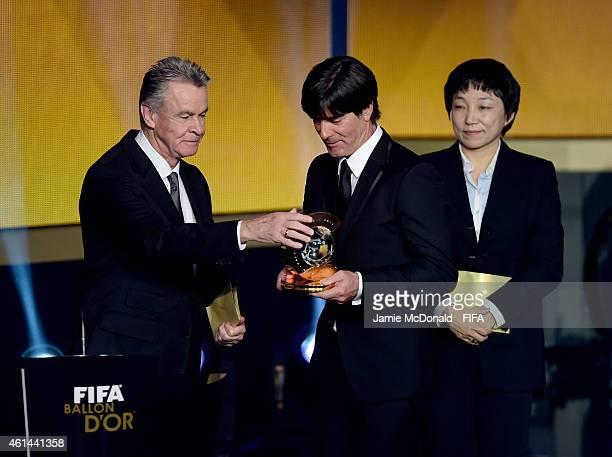 World Coach of the Year for Men's Football winner Joachim Loew of Germany receives his award from Ottmar Hitzfeld during the FIFA Ballon d'Or Gala...