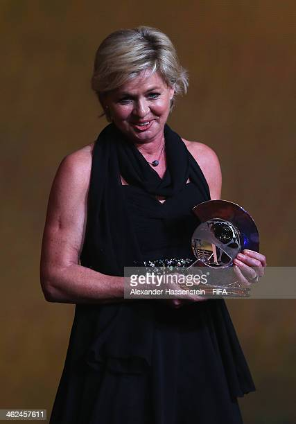 World Coach of the Year for Women's Football winner and manager of the Germany women's team Silvia Neid collects her award during the FIFA Ballon...