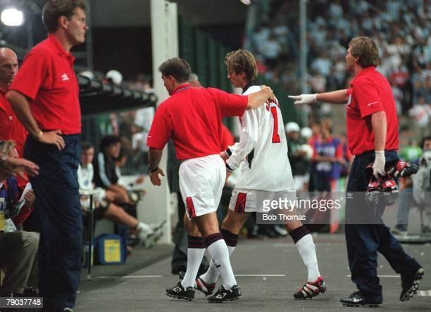 World Cup 1998 Finals St Etienne France 30th June England 2 v Argentina 2 England's David Beckham walks past coach Glenn Hoddle after he was sent off...