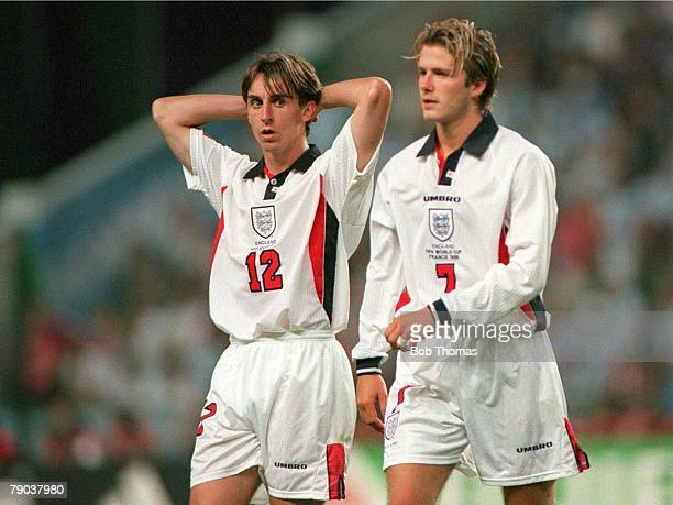 World Cup 1998 Finals St Etienne France 30th June England 2 v Argentina 2 England's Gary Neville looks over as David Beckham leaves the field after...
