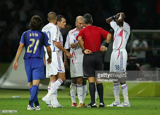 Zinedine Zidane of France talks to referee Horacio Marcelo Elizondo after being shown the red card for head butting Marco Materazzi of Italy