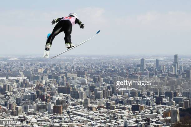 World Cup champion Sara Takanashi flies in the northern Japan city of Sapporo on March 5 during the women's large hill competition at the...