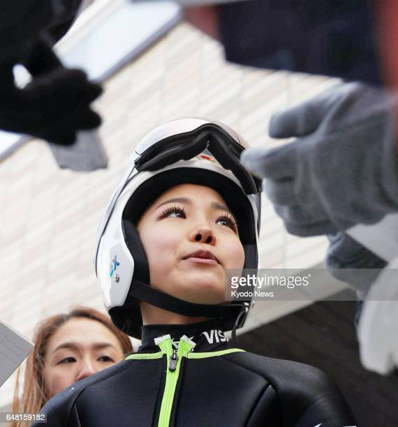 World Cup champion Sara Takanashi is surrounded by reporters after finishing second behind Yuki Ito in the women's large hill competition at the...