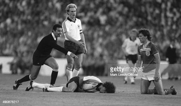 World Cup England v West Germany in Madrid Referee Coelho points for a foul after Bryan Robson had flattened Paul Breitner