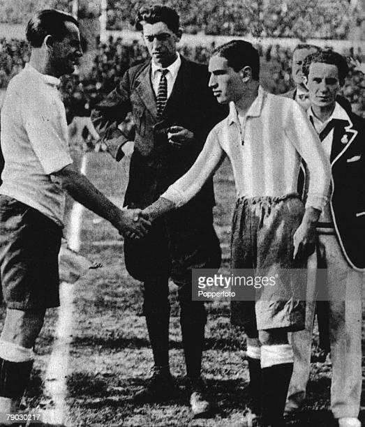 World Cup Final 1930 Montevideo Uruguay Uruguay 4 v Argentina 2 Belgian referee John Langenus looks on as Uruguay's captain Jose Nasazzi shakes hands...