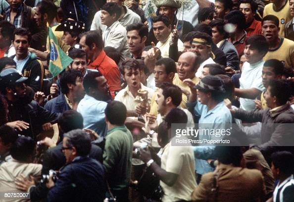 World Cup Final 1970 Mexico City Mexico 21st June Brazil 4 v Italy 1 Brazil's captain Carlos Alberto holds the World Cup trophy as he is surrounded...