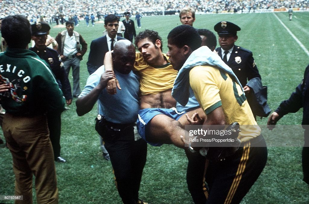 World Cup Final 1970, Mexico City, Mexico, 21st June, 1970, Brazil 4 v Italy 1, Brazil's Rivelino is carried off the field by his trainers after the final whistle went and the pitch was invaded by thousands of jubilant fans following Brazil's World Cup success