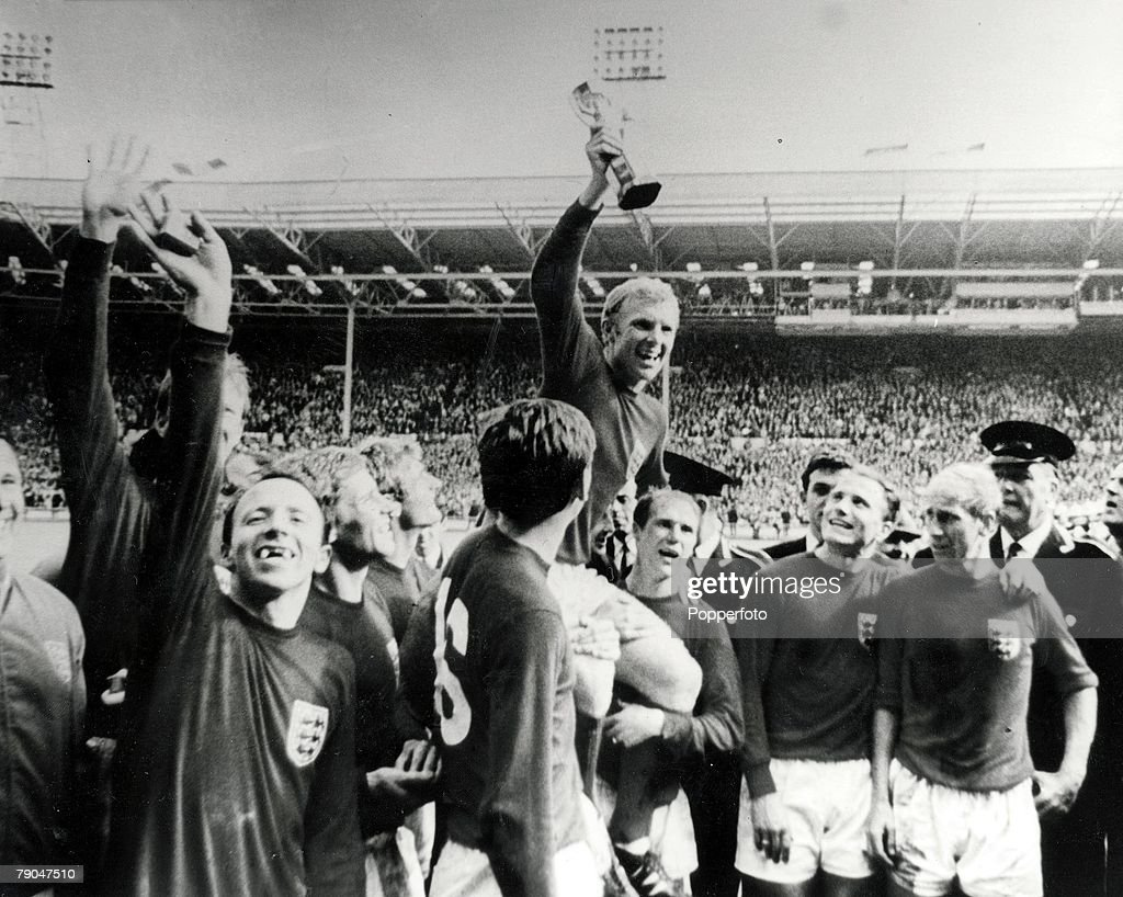 World Cup Final, 1966, 30th July, 1966, Wembley Stadium, England, England 4 v West Germany 2, Englands captain <a gi-track='captionPersonalityLinkClicked' href=/galleries/search?phrase=Bobby+Moore&family=editorial&specificpeople=206646 ng-click='$event.stopPropagation()'>Bobby Moore</a> holds aloft the Jules Rimet World Cup trophy as he sits on the shoulders of his teammates, from left to right: <a gi-track='captionPersonalityLinkClicked' href=/galleries/search?phrase=Jack+Charlton&family=editorial&specificpeople=453447 ng-click='$event.stopPropagation()'>Jack Charlton</a> (behind), <a gi-track='captionPersonalityLinkClicked' href=/galleries/search?phrase=Nobby+Stiles&family=editorial&specificpeople=220308 ng-click='$event.stopPropagation()'>Nobby Stiles</a>, <a gi-track='captionPersonalityLinkClicked' href=/galleries/search?phrase=Alan+Ball+-+World+Cup+Winner&family=editorial&specificpeople=213401 ng-click='$event.stopPropagation()'>Alan Ball</a>, <a gi-track='captionPersonalityLinkClicked' href=/galleries/search?phrase=Roger+Hunt&family=editorial&specificpeople=703571 ng-click='$event.stopPropagation()'>Roger Hunt</a>, <a gi-track='captionPersonalityLinkClicked' href=/galleries/search?phrase=Martin+Peters&family=editorial&specificpeople=643328 ng-click='$event.stopPropagation()'>Martin Peters</a>, <a gi-track='captionPersonalityLinkClicked' href=/galleries/search?phrase=Bobby+Moore&family=editorial&specificpeople=206646 ng-click='$event.stopPropagation()'>Bobby Moore</a>, <a gi-track='captionPersonalityLinkClicked' href=/galleries/search?phrase=Ray+Wilson&family=editorial&specificpeople=908340 ng-click='$event.stopPropagation()'>Ray Wilson</a>, <a gi-track='captionPersonalityLinkClicked' href=/galleries/search?phrase=George+Cohen&family=editorial&specificpeople=703599 ng-click='$event.stopPropagation()'>George Cohen</a> and <a gi-track='captionPersonalityLinkClicked' href=/galleries/search?phrase=Bobby+Charlton&family=editorial&specificpeople=204207 ng-click='$event.stopPropagation()'>Bobby Charlton</a>, after the match.