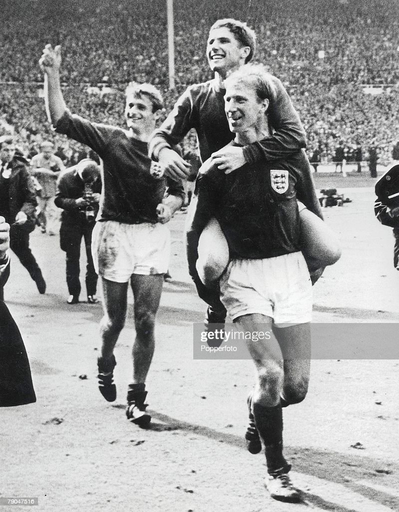 World Cup Final, 1966, 30th July, 1966, Wembley Stadium, England, England 4 v West Germany 2, England's <a gi-track='captionPersonalityLinkClicked' href=/galleries/search?phrase=Alan+Ball+-+World+Cup+Winner&family=editorial&specificpeople=213401 ng-click='$event.stopPropagation()'>Alan Ball</a> is carried on the shoulders of teammate Jack Charlton with Roger Hunt following as England celebrate becoming World Champions during the match.
