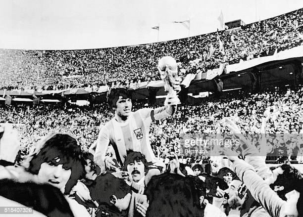 World Cup Final Argentine team captain Daniel Passarella is carried on shoulders of fans as he shows FIFA World Cup his team won by defeating Holland...