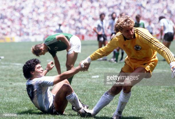 World Cup Final Azteca Stadium Mexico 29th June Argentina 3 v West Germany 2 Argentina's Diego Maradona is helped up from the ground by West German...