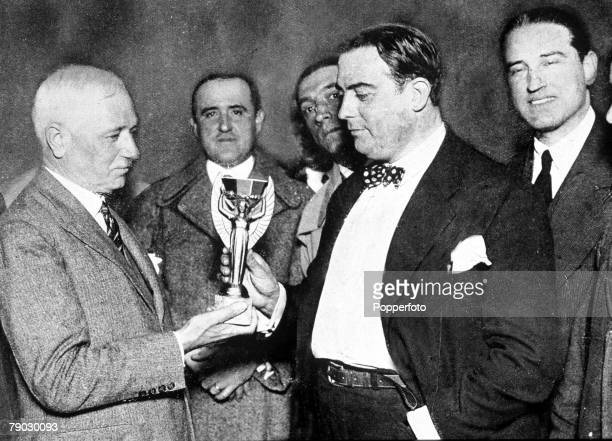 World Cup Final Montevideo Uruguay Uruguay 4 v Argentina 2 FIFA President Jules Rimet presents the Jules Rimet trophy to Dr Raul Jude of the...