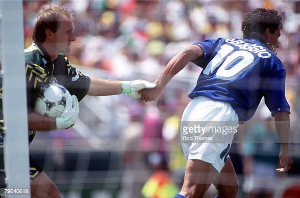 World Cup Final Pasadena USA 17th July Brazil 0 v Italy 0 Brazilian goalkeeper Taffarel sportingly tugs the arm of Italy's Roberto Baggio