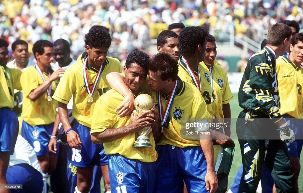 World Cup Final Pasadena USA 17th July Brazil 0 v Italy 0 Brazil's captain Dunga celebrates with teammate Romario as the team celebrate their World...