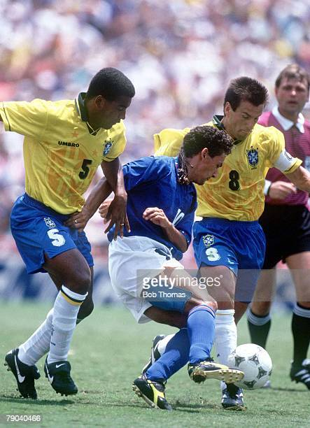 World Cup Final Pasadena USA 17th July Brazil 0 v Italy 0 Italy's Roberto Baggio challenged by by Brazil's Dunga and Mauro Silva