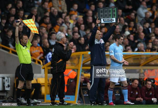 World Cup final referee and fourth offical for the day Howard Webb holds up the board as Manchester City's Adam Johnson waits on the touchline to be...