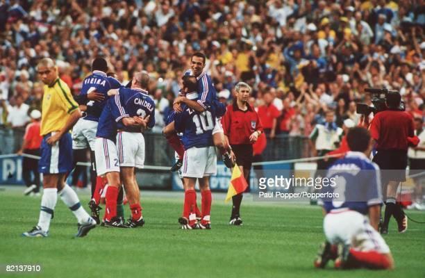 World Cup Final St Denis France 12th July France 3 v Brazil 0 France's Zinedine Zidane with teammate Djorkaeff after their victory