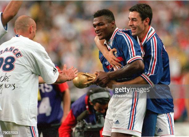 World Cup Final St Denis France 12th July France 3 v Brazil 0 Marcel Desailly and Robert Pires have fun as players take turns to hold the World Cup...