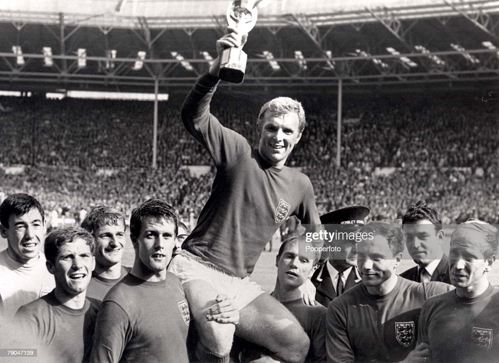 World Cup Final, 1966, Wembley, England, 30th July, 1966 England 4 v West Germany 2, England's captain <a gi-track='captionPersonalityLinkClicked' href=/galleries/search?phrase=Bobby+Moore&family=editorial&specificpeople=206646 ng-click='$event.stopPropagation()'>Bobby Moore</a> holds aloft the Jules Rimet World Cup trophy as he sits on the shoulders of his teammates, from left to right: <a gi-track='captionPersonalityLinkClicked' href=/galleries/search?phrase=Gordon+Banks&family=editorial&specificpeople=215465 ng-click='$event.stopPropagation()'>Gordon Banks</a>, <a gi-track='captionPersonalityLinkClicked' href=/galleries/search?phrase=Alan+Ball+-+World+Cup+Winner&family=editorial&specificpeople=213401 ng-click='$event.stopPropagation()'>Alan Ball</a>, <a gi-track='captionPersonalityLinkClicked' href=/galleries/search?phrase=Roger+Hunt&family=editorial&specificpeople=703571 ng-click='$event.stopPropagation()'>Roger Hunt</a>, <a gi-track='captionPersonalityLinkClicked' href=/galleries/search?phrase=Geoff+Hurst&family=editorial&specificpeople=206880 ng-click='$event.stopPropagation()'>Geoff Hurst</a>, <a gi-track='captionPersonalityLinkClicked' href=/galleries/search?phrase=Bobby+Moore&family=editorial&specificpeople=206646 ng-click='$event.stopPropagation()'>Bobby Moore</a>, <a gi-track='captionPersonalityLinkClicked' href=/galleries/search?phrase=Ray+Wilson&family=editorial&specificpeople=908340 ng-click='$event.stopPropagation()'>Ray Wilson</a>, <a gi-track='captionPersonalityLinkClicked' href=/galleries/search?phrase=George+Cohen&family=editorial&specificpeople=703599 ng-click='$event.stopPropagation()'>George Cohen</a> and <a gi-track='captionPersonalityLinkClicked' href=/galleries/search?phrase=Bobby+Charlton&family=editorial&specificpeople=204207 ng-click='$event.stopPropagation()'>Bobby Charlton</a>, after the match.