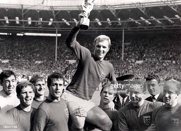 World Cup Final Wembley England 30th July 1966 England 4 v West Germany 2 England's captain Bobby Moore holds aloft the Jules Rimet World Cup trophy...