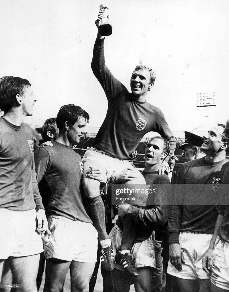 World Cup Final, 1966, Wembley, England, 30th July, 1966 England 4 v West Germany 2, England's captain <a gi-track='captionPersonalityLinkClicked' href=/galleries/search?phrase=Bobby+Moore&family=editorial&specificpeople=206646 ng-click='$event.stopPropagation()'>Bobby Moore</a> holds aloft the Jules Rimet World Cup trophy as he sits on the shoulders of his teammates, from left to right: <a gi-track='captionPersonalityLinkClicked' href=/galleries/search?phrase=Martin+Peters&family=editorial&specificpeople=643328 ng-click='$event.stopPropagation()'>Martin Peters</a>, <a gi-track='captionPersonalityLinkClicked' href=/galleries/search?phrase=Geoff+Hurst&family=editorial&specificpeople=206880 ng-click='$event.stopPropagation()'>Geoff Hurst</a>, <a gi-track='captionPersonalityLinkClicked' href=/galleries/search?phrase=Bobby+Moore&family=editorial&specificpeople=206646 ng-click='$event.stopPropagation()'>Bobby Moore</a>, <a gi-track='captionPersonalityLinkClicked' href=/galleries/search?phrase=Ray+Wilson&family=editorial&specificpeople=908340 ng-click='$event.stopPropagation()'>Ray Wilson</a> and <a gi-track='captionPersonalityLinkClicked' href=/galleries/search?phrase=George+Cohen&family=editorial&specificpeople=703599 ng-click='$event.stopPropagation()'>George Cohen</a>, after the match.