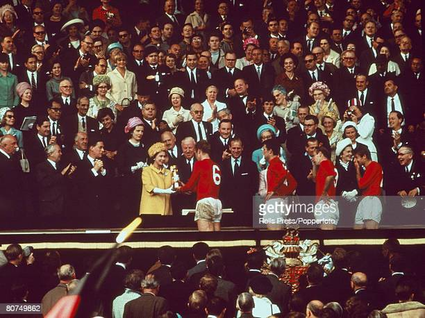 World Cup Final Wembley Stadium England 30th July England 4 v West Germany 2 England captain Bobby Moore receives the trophy from HRH Queen Elizabeth...