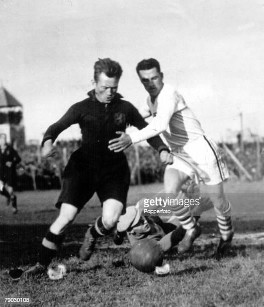 World Cup Finals 1930 Uruguay USA v Belgium Belgium's Nicholas Hoydonck tries to clear the ball challenged by USA's Bertram Patenaude