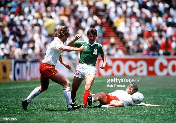World Cup Finals Azteca Stadium Mexico 3rd June Mexico 2 v Belgium 1 Mexico's Javier Aguirre clears the ball despite the attention of Belgium's Frank...