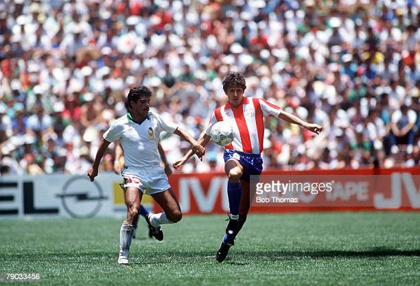 World Cup Finals Azteca Stadium Mexico 7th June Mexico 1 v Paraguay 1 Mexico's Luis Flores battles for the ball with Paraguay's Julio Cesar Romero