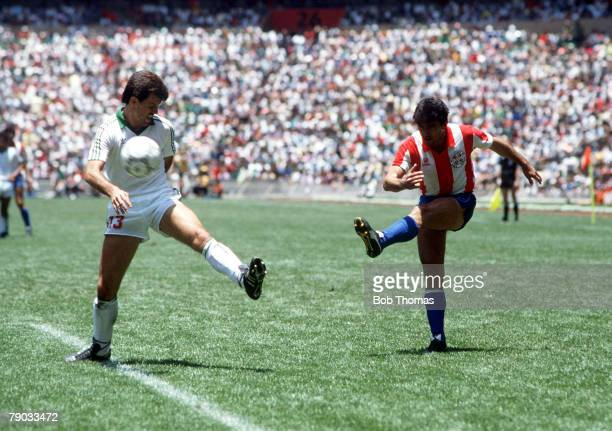 World Cup Finals Azteca Stadium Mexico 7th June Mexico 1 v Paraguay 1 Paraguay's Adolfino Canete shoots past Mexico's Javier Aguirre