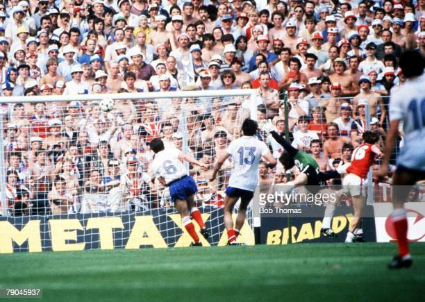 World Cup Finals Bilbao Spain 16th June England 3 v France 1 England's Bryan Robson beats France's goalie Jean Luc Ettori to score England's second...