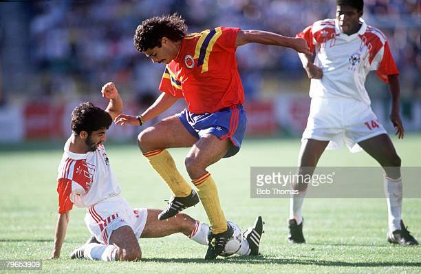 World Cup Finals Bologna Italy 10th June Colombia 2 v United Arab Emirates 0 Colombia's Gildardo Gomez is challenged for the ball by UAE's Adnan Al...