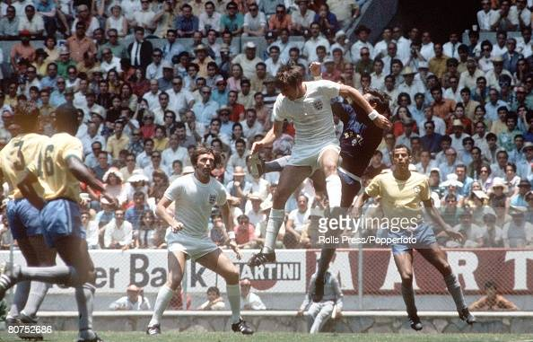 World Cup Finals Guadalajara Mexico 7th June England 0 v Brazil 1 England forward Martin Peters jumps for the ball with Brazilian goalkeeper Felix as...