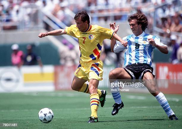 World Cup Finals Los Angeles USA 3rd July Romania 3 v Argentina 2 Romania's Munteanu gets away from Argentina's Gabriel Batistuta