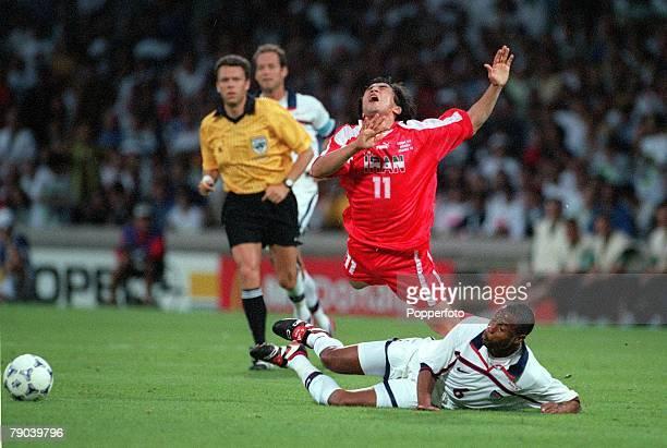 World Cup Finals Lyon France 21st JUNE 1998 USA 1 v Iran 2 Iran's Khodadad Azizi is tackled by USA's David Regis