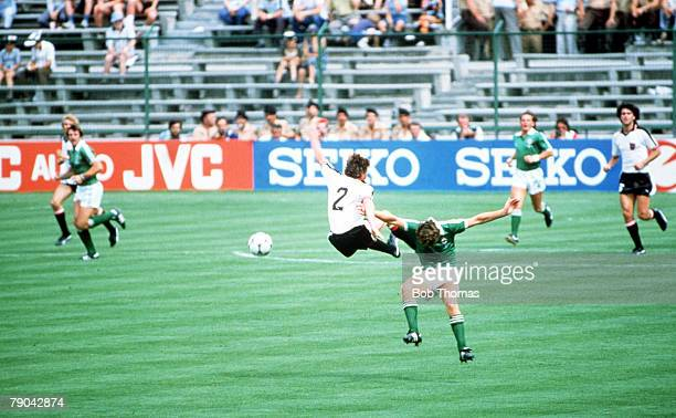 World Cup Finals Madrid Spain 1st July Austria 2 v Northern Ireland 2 Northern Ireland's Norman Whiteside is outjumped by Austria's Bernd Krauss