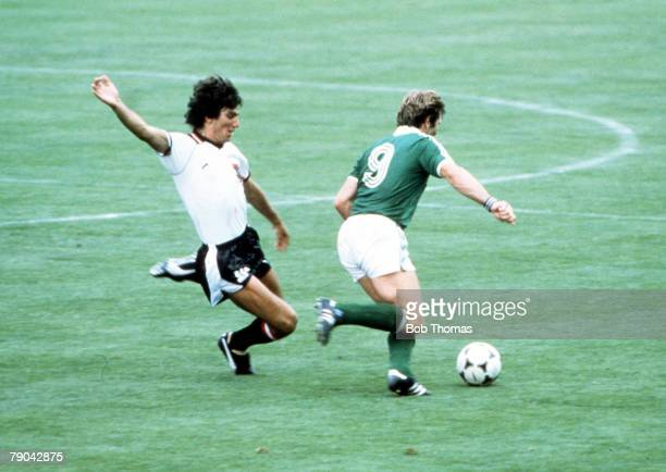World Cup Finals Madrid Spain 1st July Austria 2 v Northern Ireland 2 Northern Ireland's Gerry Armstrong is tackled by Austria's Reinhold Hintermayer