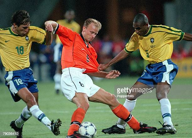 World Cup Finals Marseille France SemiFinal 7th July 1998 Brazil 1 v Holland 1 Dennis Begkamp of Holland opposed by Brazil's Leonardo and Cesar...