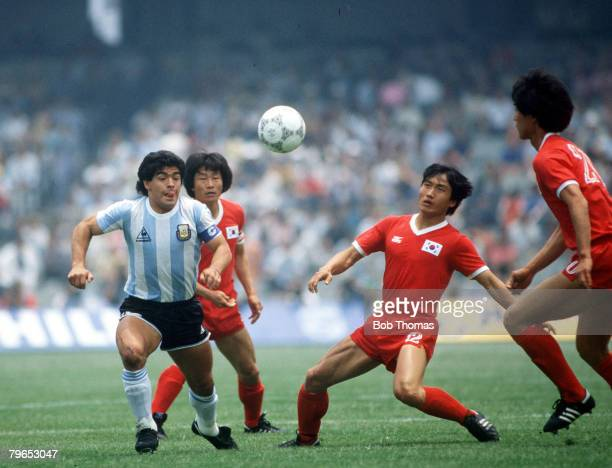 World Cup Finals Mexico City Mexico 2nd June Argentina 3 v South Korea 1 Argentina's Diego Maradona challenges for the ball with South Korea's Pyung...