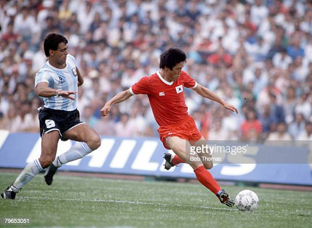 World Cup Finals Mexico City Mexico 2nd June Argentina 3 v South Korea 1 South Korea's Bum Ku Cha is chased by Argentina's Jose Luis Brown