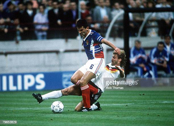 World Cup Finals Milan Italy 10th June West Germany 4 v Yugoslavia 1 Yugoslavia's Davor Jozic is challenged for the ball by West Germany's Rudi...