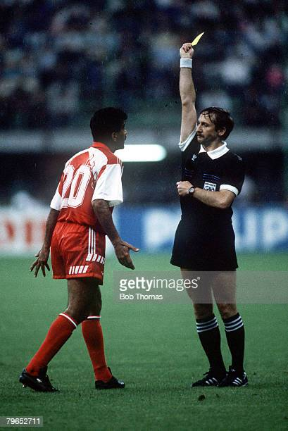 World Cup Finals Milan Italy 15th June West Germany 5 v United Arab Emirates 1 United Arab Emirates' Yousuf Hussain Mohammad is shown the yellow card...