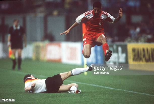 World Cup Finals Milan Italy 15th June West Germany 5 v United Arab Emirates 1 UAE's Hussain Abbas hurdles the sliding challenge of West Germany's...
