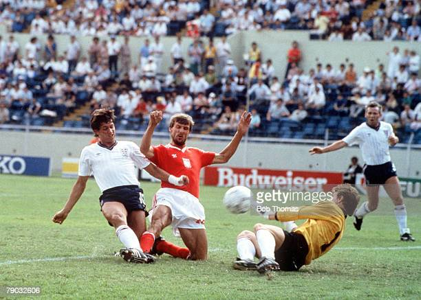 World Cup Finals Monterrey Mexico 11th June England 3 v Poland 0 England's Gary Lineker slides the ball past Polish goalkeeper Jozef Mlynarczyk to...